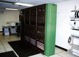 Racks and racks of old switch equipment , parted out for scrap.